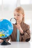 Examining globe. Royalty Free Stock Image