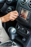 Examining her new car. Close-up of woman in formalwear touching dashboard with finger while sitting in car Stock Photos