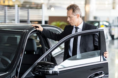 Examining his new car. Royalty Free Stock Photography