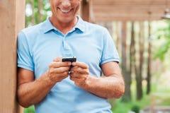 Examining his new smart phone. Royalty Free Stock Photo