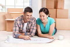 Examining a house plan. Stock Photography