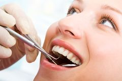 Examining mouth Royalty Free Stock Images