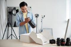 Examining new lamp Royalty Free Stock Photos