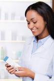 Examining new medicine. Royalty Free Stock Photography