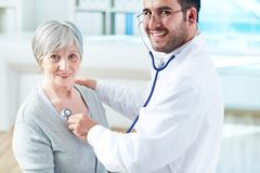 Examining patient Stock Images