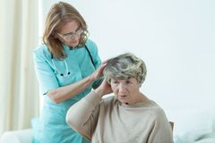Examining a patient Stock Photo