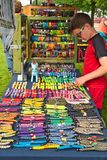 Examining summer festival merchandise Royalty Free Stock Images