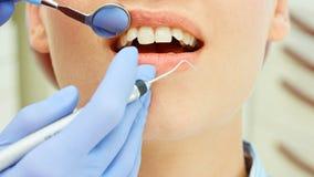 Examining teeth Royalty Free Stock Photo