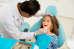 Examining teeth and gums Stock Photo