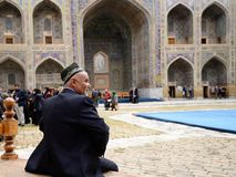 Example of architecture Samarkand, Uzbekistan, Silk Route. SAMARKAND, UZBEKISTAN - 22 APRIL 2019: The Uzbek tourist with the admiration is examining monuments of stock images