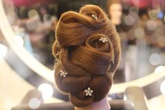 Bride hairstyle with diamond decoration. A example bride hairstyle decorate with diamond flower on hair mannequin royalty free stock image