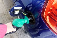 Car being filled with petrol. An example of a car automobile being filled with petrol stock images