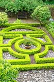 Formal Garden and Small Maze. An example of a formal garden with a small ornamental hedge maze Royalty Free Stock Images