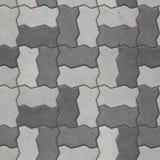 Dichromatic interlocking blocks paving, seamless texture. Example of gray interlocking paver brick texture stock image