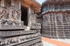 Example of great Indian architecture in ancient temples of Halebidu, with carved door and walls with Hindu gods. India. Royalty Free Stock Images