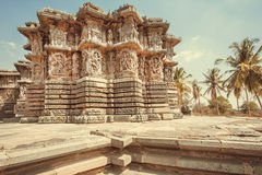 Example of historical architecture in India. 12th century temple with carvings on stone walls, India. Stock Photos
