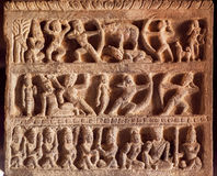 Example of Indian art carvings with war and peace life of ancient people at 7th century temples in Pattadakal, India. Royalty Free Stock Images