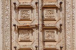 Example of Indian wood carvings with ancient life of ancient people, on door of the Palace of Mysore, India. Stock Photography