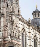 Example of Italian architecture of the 14th century, facade of Duomo di Siena with sculptures and reliefs, Tuscany. UNESCO World Heritage Site royalty free stock photography