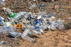 An example of plastic and other litter thrown in the desert causing potential environmental concerns. Recycling is a work in proce royalty free stock photos