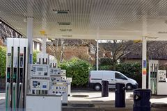 Garage Forecourt and Petrol or Gasoline Pumps. An example of pumps used to fill automobiles, cars and other vehicles, in a garage filling station forecourt Stock Image