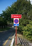 Road signs: no stop, stand and park, fire path Stock Photos