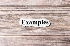 Examples of the word on paper. concept. Words of Examples on a wooden background royalty free stock images