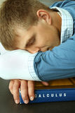 Before exams. College student sleeping on a calculus textbook before the exam Stock Photography