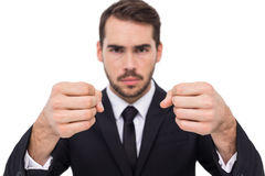 Exasperated businessman with clenched fists. On white background stock photography