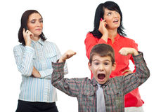Exasperated child shout about women on phone. Exasperated child about two women who talk on the phone mobile and do not pay attention to him isolated on white royalty free stock image