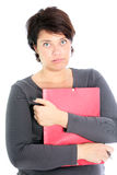 Exasperated, overworked woman clutching paperwork Stock Photo