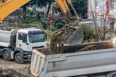 Exavator loading earth in the truck on construction site Royalty Free Stock Photos