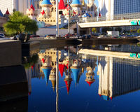 Excalibur Casino Reflected in Las Vegas Pool. Twice the fantasy turrets atop the Excalibur hotel-casino: reflected in the mirror like surface of an artificial Royalty Free Stock Photo
