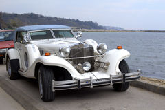 Excalibur classic car. Excalibur automobile compartment at the sea coast Stock Photos