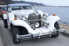 Excalibur classic car on the beach. Classic Excalibur automobile compartment on the beach Stock Images