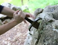Excalibur the famous sword in the stone of king Arthur in the fo Royalty Free Stock Photos