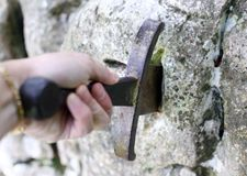 Excalibur the famous sword in the stone of king Arthur in the fo Royalty Free Stock Images