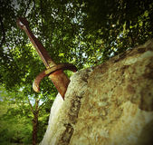 Excalibur the famous sword in the stone of king Arthur in the fo Stock Photos