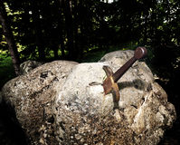 Excalibur the famous sword in the stone of king Arthur Royalty Free Stock Image