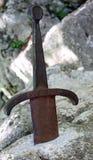 Excalibur också kallade Caliburn är ett legendariskt svärd arkivbild