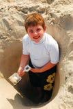 Excavación en la playa fotografía de archivo libre de regalías