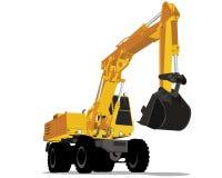 Excavador amarillo con las ruedas Foto de archivo