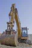 Excavador en el emplazamiento de la obra Fotografía de archivo