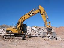 Excavador en el trabajo Foto de archivo libre de regalías