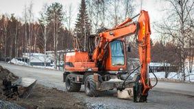 Excavador parqueado, Finlandia Imagen de archivo libre de regalías