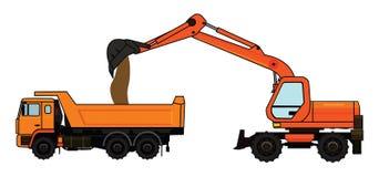 excavador rodado y camiones volquete Imágenes de archivo libres de regalías