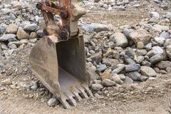 Excavador viejo Bucket On Site Foto de archivo libre de regalías