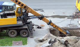 Excavate. Replacement of old water pipes. Excavator dug a trench Stock Photos