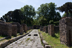 Excavated main road and houses of Pompeii Royalty Free Stock Photo