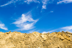 Excavated Mud and Blue Sky Royalty Free Stock Image